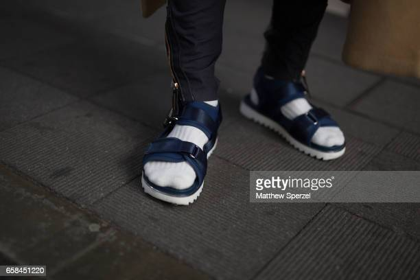 A guest is seen on the street wearing navy sandals during Tokyo Fashion Week on March 25 2017 in Tokyo Japan