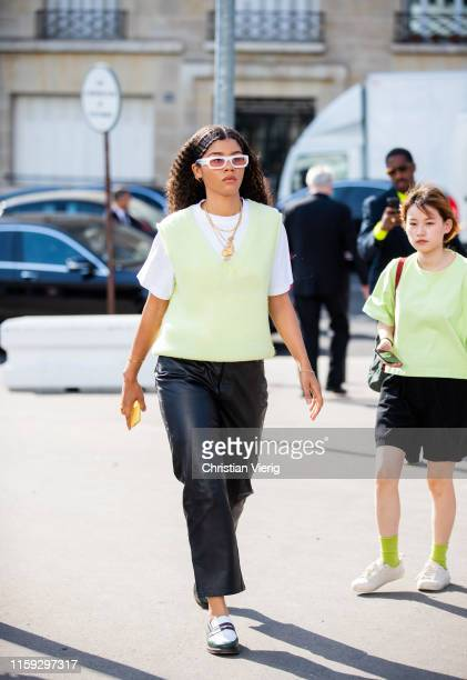 Guest is seen outside Acne during Paris Fashion Week - Haute Couture Fall/Winter 2019/2020 on June 30, 2019 in Paris, France.