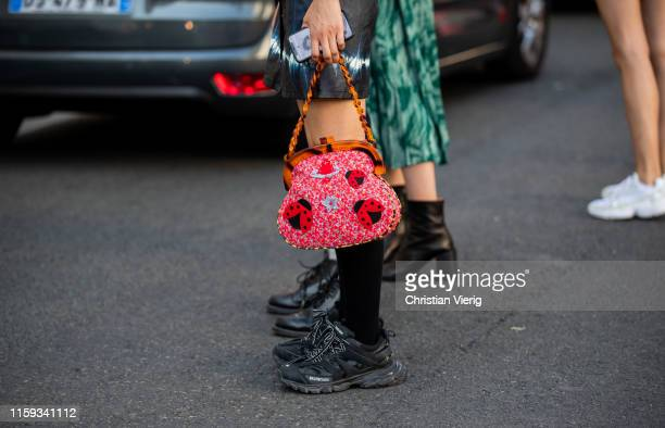 A guest is seen outside Acne during Paris Fashion Week Haute Couture Fall/Winter 2019/2020 on June 30 2019 in Paris France