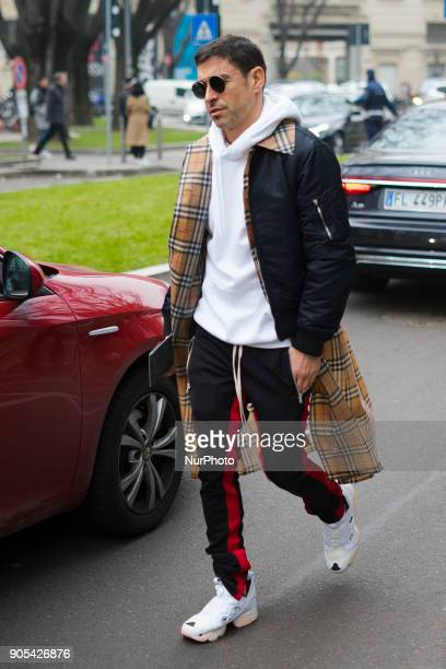 Guest is seen outside at Armani and Fendi fashion show during Milan Men's Fashion Week Fall/Winter 2018/19 on January 15 2018 in Milan Italy