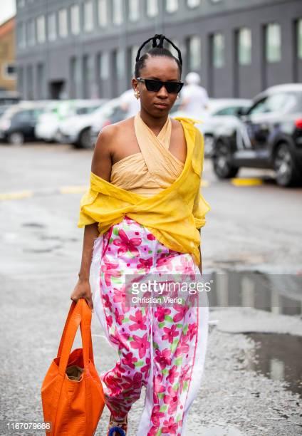 Guest is seen outside Baum und Pferdgarten during Copenhagen Fashion Week Spring/Summer 2020 on August 08, 2019 in Copenhagen, Denmark.