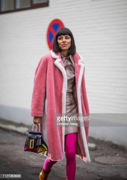 A guest is seen outside Baum und Pferdgarten during the Copenhagen Fashion Week Autumn/Winter 2019 Day 3 on January 31 2019 in Copenhagen Denmark