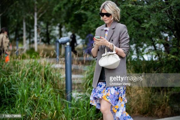 Guest is seen outside Brøgger during Copenhagen Fashion Week Spring/Summer 2020 on August 06, 2019 in Copenhagen, Denmark.