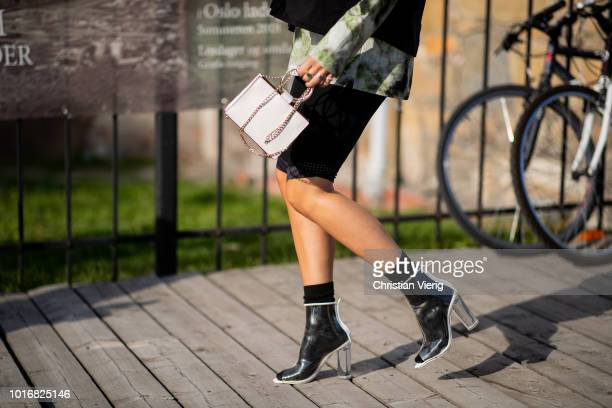 A guest is seen outside byTiMo during Oslo Runway SS19 on August 14 2018 in Oslo Norway