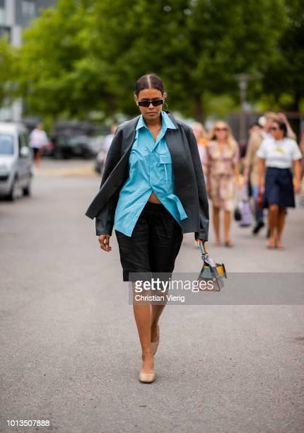 A guest is seen outside Cecilie Bahnsen during the Copenhagen Fashion Week Spring/Summer 2019 on August 8 2018 in Copenhagen Denmark