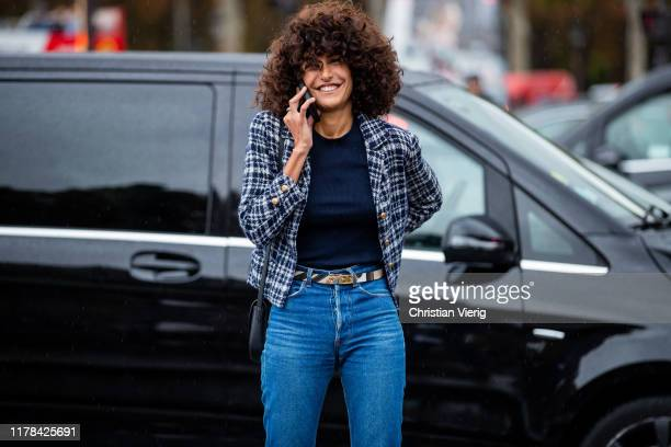 Guest is seen outside Chanel during Paris Fashion Week Womenswear Spring Summer 2020 on October 01, 2019 in Paris, France.