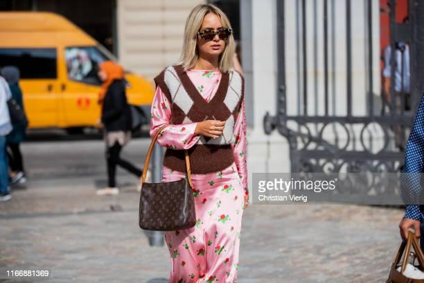 A guest is seen outside Designers Remix during Copenhagen Fashion Week Spring/Summer 2020 on August 08 2019 in Copenhagen Denmark