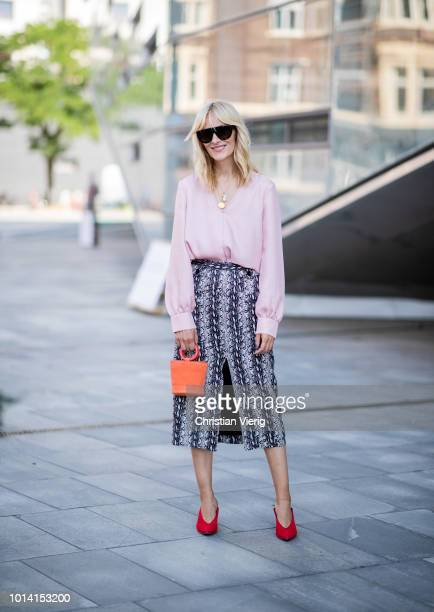 A guest is seen outside Designers Remix during the Copenhagen Fashion Week Spring/Summer 2019 on August 9 2018 in Copenhagen Denmark