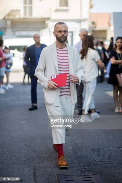 A guest is seen outside Diesel during Milan Men's Fashion Week Spring/Summer 2018 on June 17 2017 in Milan Italy