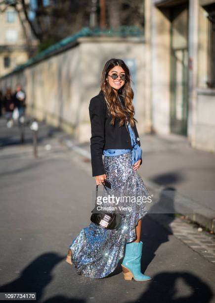A guest is seen outside Dior during Paris Fashion Week Haute Couture Spring Summer 2019 on January 21 2019 in Paris France