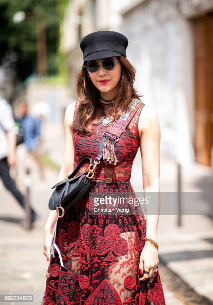 A guest is seen outside Dior on day two during Paris Fashion Week Haute Couture FW18 on July 2 2018 in Paris France