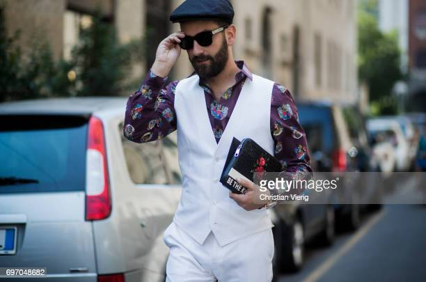 A guest is seen outside Dolce Gabbana during Milan Men's Fashion Week Spring/Summer 2018 on June 17 2017 in Milan Italy