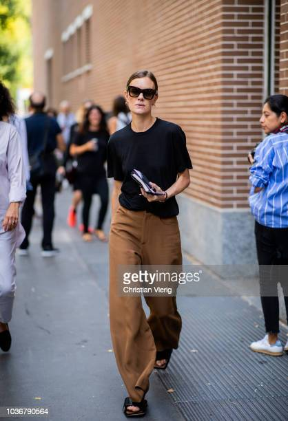A guest is seen outside Fendi during Milan Fashion Week Spring/Summer 2019 on September 20 2018 in Milan Italy