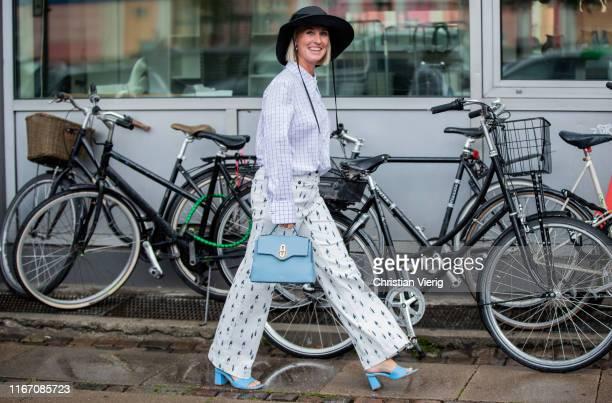 Guest is seen outside Ganni during Copenhagen Fashion Week Spring/Summer 2020 on August 08, 2019 in Copenhagen, Denmark.