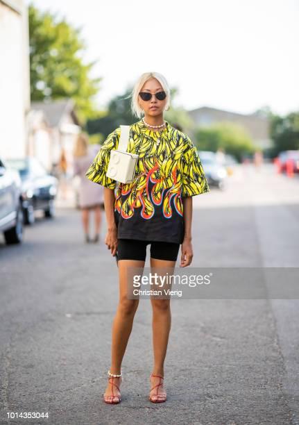 A guest is seen outside Ganni during the Copenhagen Fashion Week Spring/Summer 2019 on August 9 2018 in Copenhagen Denmark