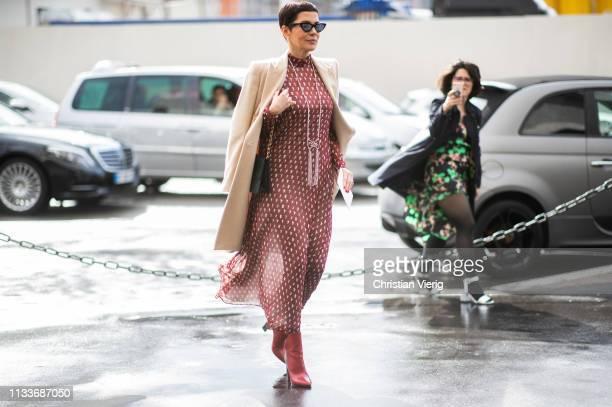 Guest is seen outside Giambattista Valli during Paris Fashion Week Womenswear Fall/Winter 2019/2020 on March 04, 2019 in Paris, France.
