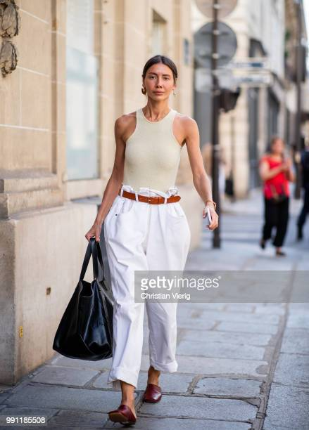 A guest is seen outside Giorgio Armani Prive on day three during Paris Fashion Week Haute Couture FW18 on July 2 2018 in Paris France