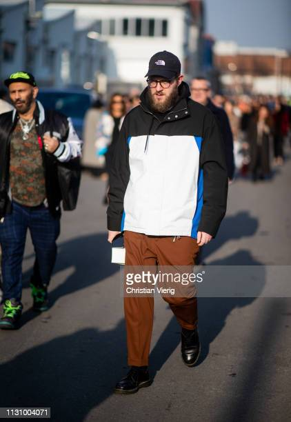 A guest is seen outside Gucci on Day 1 Milan Fashion Week Autumn/Winter 2019/20 on February 20 2019 in Milan Italy
