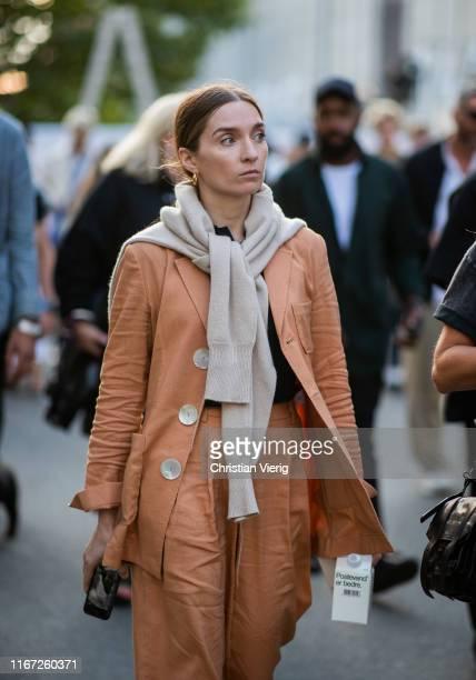 A guest is seen outside Henrik Vibskov during Copenhagen Fashion Week Spring/Summer 2020 on August 07 2019 in Copenhagen Denmark