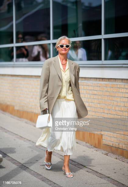 A guest is seen outside Holzweiler during Copenhagen Fashion Week Spring/Summer 2020 on August 07 2019 in Copenhagen Denmark