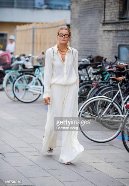 Guest is seen outside Holzweiler during Copenhagen Fashion Week Spring/Summer 2020 on August 07, 2019 in Copenhagen, Denmark.