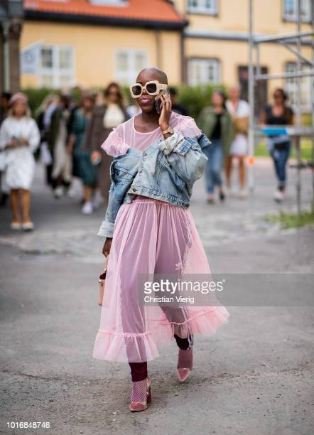 A guest is seen outside Iben during Oslo Runway SS19 on August 14 2018 in Oslo Norway