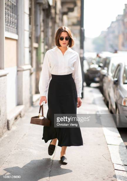 A guest is seen outside Jil Sander during Milan Fashion Week Spring/Summer 2019 on September 19 2018 in Milan Italy