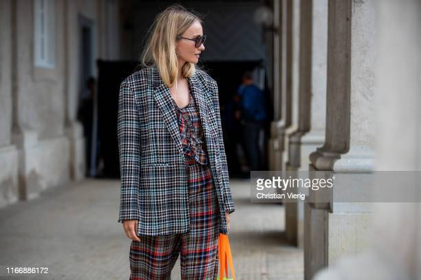 A guest is seen outside Lala Berlin during Copenhagen Fashion Week Spring/Summer 2020 on August 08 2019 in Copenhagen Denmark