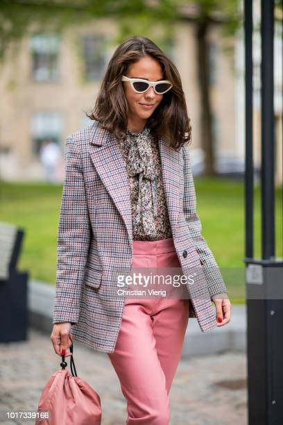 Guest is seen outside Line of Oslo during Oslo Runway SS19 on August 15, 2018 in Oslo, Norway.