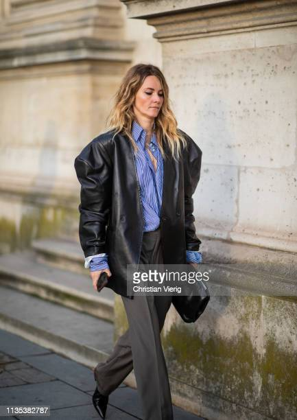 A guest is seen outside Louis Vuitton during Paris Fashion Week Womenswear Fall/Winter 2019/2020 on March 05 2019 in Paris France