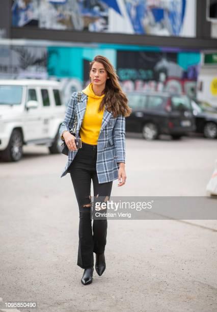 A guest is seen outside Marina Hoermanseder during the Berlin Fashion Week Autumn/Winter 2019 on January 17 2019 in Berlin Germany
