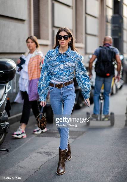 A guest is seen outside Max Mara during Milan Fashion Week Spring/Summer 2019 on September 20 2018 in Milan Italy