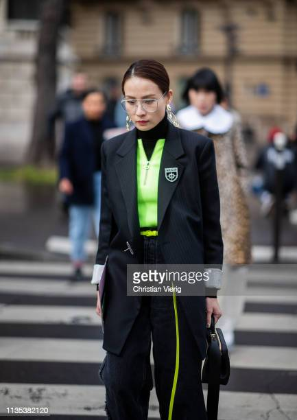 A guest is seen outside Miu Miu during Paris Fashion Week Womenswear Fall/Winter 2019/2020 on March 05 2019 in Paris France
