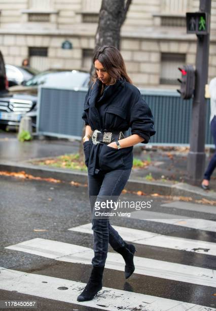 A guest is seen outside Miu Miu during Paris Fashion Week Womenswear Spring Summer 2020 on October 01 2019 in Paris France