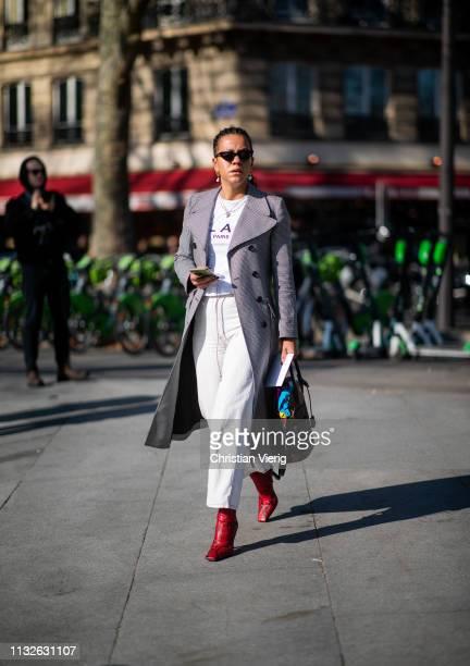 Guest is seen outside Mugler during Paris Fashion Week Womenswear Fall/Winter 2019/2020 on February 27, 2019 in Paris, France.