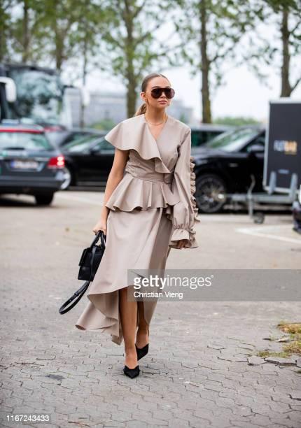 Guest is seen outside Munthe during Copenhagen Fashion Week Spring/Summer 2020 on August 07, 2019 in Copenhagen, Denmark.