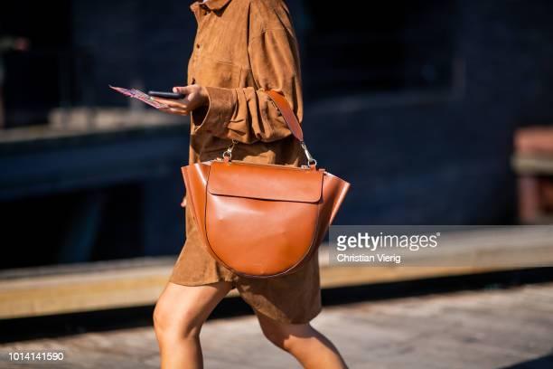 A guest is seen outside Munthe during the Copenhagen Fashion Week Spring/Summer 2019 on August 9 2018 in Copenhagen Denmark