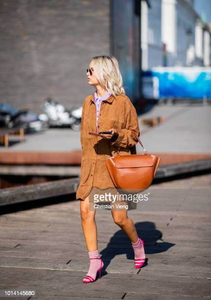 A guest is seen outside Munthe during the Copenhagen Fashion Week Spring/Summer 2019 on August 9 2018 in Copenhagen Denmark