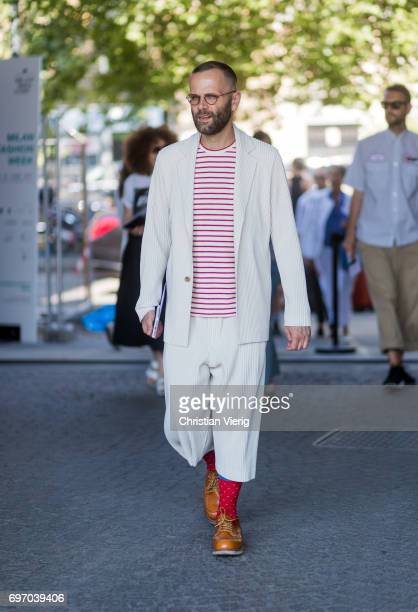 A guest is seen outside Neil Barrett during Milan Men's Fashion Week Spring/Summer 2018 on June 17 2017 in Milan Italy