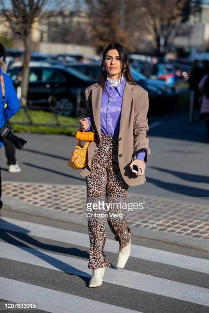 A guest is seen outside Prada during Milan Fashion Week Fall/Winter 20202021 on February 20 2020 in Milan Italy