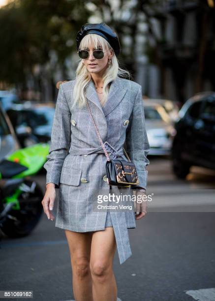 A guest is seen outside Prada during Milan Fashion Week Spring/Summer 2018 on September 21 2017 in Milan Italy
