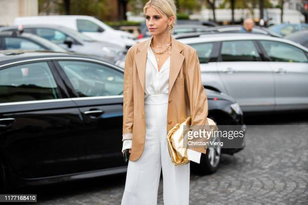 A guest is seen outside Rochas during Paris Fashion Week Womenswear Spring Summer 2020 on September 25 2019 in Paris France