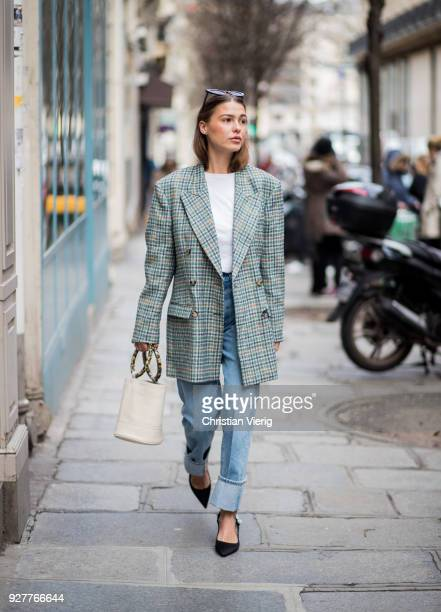 A guest is seen outside Sacai during Paris Fashion Week Womenswear Fall/Winter 2018/2019 on March 5 2018 in Paris France