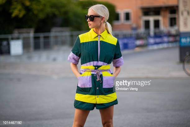 A guest is seen outside Saks Potts during the Copenhagen Fashion Week Spring/Summer 2019 on August 9 2018 in Copenhagen Denmark