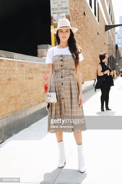 Guest is seen outside Skylight Clarkson wearing beige hat and dress white Tshirt during New York Fashion Week on September 11 2017 in New York City