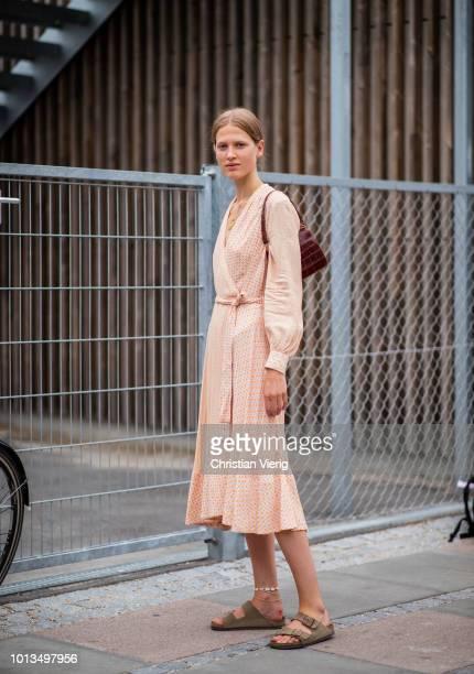 A guest is seen outside Stine Goya during the Copenhagen Fashion Week Spring/Summer 2019 on August 8 2018 in Copenhagen Denmark