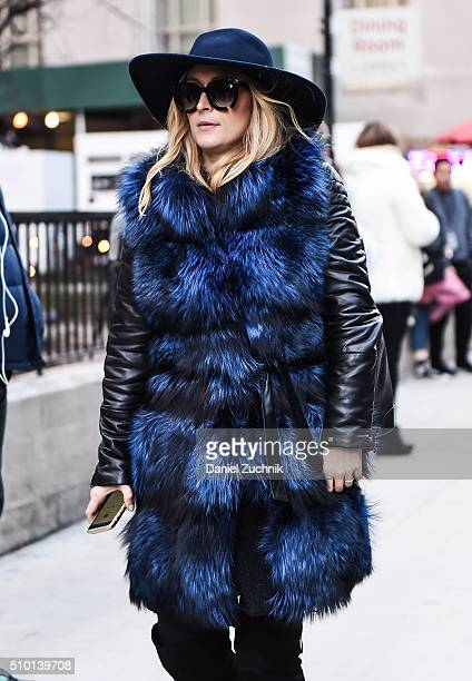 A guest is seen outside the Alexander Wang show wearing a blue and black fur coat during New York Fashion Week Women's Fall/Winter 2016 on February...