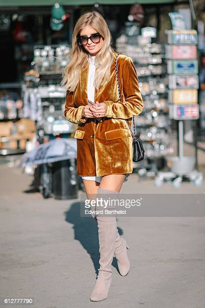 A guest is seen outside the Chanel show during Paris Fashion Week Spring Summer 2017 at Grand Palais on October 4 2016 in Paris France