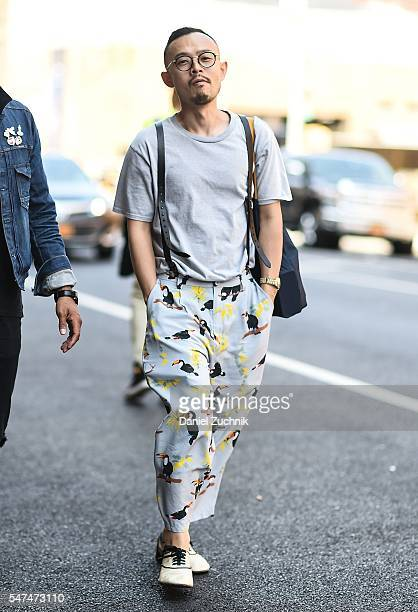 A guest is seen outside the Palmiers Du Mal show wearing Pelican print pants during New York Fashion Week Men's S/S 2017 Day 4 on July 14 2016 in New...