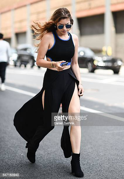 A guest is seen outside the Rochambeau show wearing a black cut out dress during New York Fashion Week Men's S/S 2017 Day 3 on July 13 2016 in New...